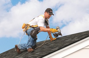 Contractor at Work - Roof Replacements - Roof Repairs